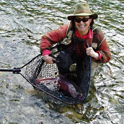 Sandra with Salmon at Lake Creek, Alaska